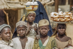 Kano Children, some selling pastries from heads