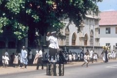 Lagos policeman and school children in white