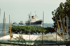 Ship coming into harbor seen from living quarters